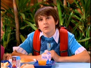 "Mitchel Musso appears as Oliver Oken in a lunchroom scene from one of the first episodes of ""Hannah Montana."""
