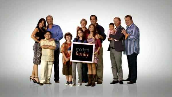 "The three families of ""Modern Family"" -- the Pritchett-Delgados, the Dunphys, and the Pritchett-Tuckers -- appear with the show's title card in the picture frame-based opening theme sequence."