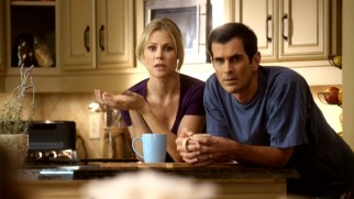 Claire (Julie Bowen) and Phil (Ty Burrell) observe two of their three kids getting along... briefly.