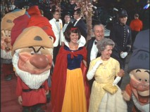 Walt Disney is joined by Snow White and the Seven Dwarfs at the Gala World Premiere.