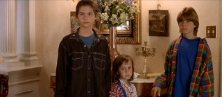"Playing the Hillard children with their layered '90s looks are Lisa Jakub (""Independence Day""), Mara Wilson (""Matilda""), and Matthew Lawrence (""Boy Meets World"")."