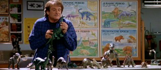 """Jurassic Park"" wasn't the only 1993 blockbuster showcasing some high-tech dinosaurs. Or: give Robin Williams an empty room and some toys and he's one happy guy."