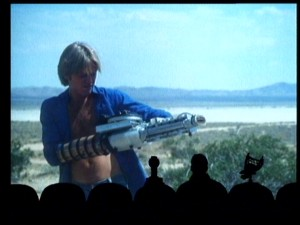 "Teenage loner Billy (Kim Milford) tries his arm at desert laserblasting in the delightfully terrible ""Laserblast."""