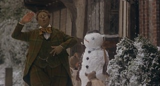 Toad waddles off cheerfully in the company of an English snowman.