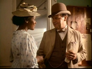 Private eye and director of the precursor to the FBI William J. Burns (Paul Dooley) thanks Ms. Carter (Loretta Devine) for her undercover work and accepts her useful contribution.