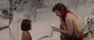 Mr. Tumnus (James McAvoy) makes a point to Lucy (Georgie Henley) in her first moments on Narnia.