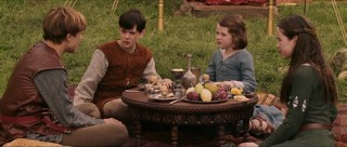 The four Pevensie siblings share a meal.