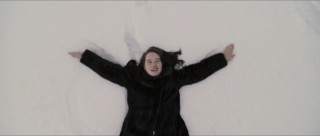 Susan (Anna Popplewell) makes a snow angel in the Pevensie children's extended introduction to Narnia.