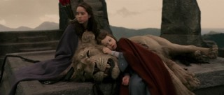 Susan and Lucy are at Aslan's side on the Stone Table.