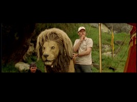 "Two crew members take care of Aslan's stand-in in ""The Bloopers of Narnia."""