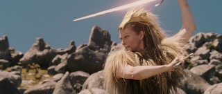 The White Witch wields a sword.