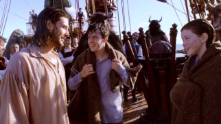 Edmund (Skandar Keynes) and Lucy (Georgie Henley) Pevensie get a warm welcome aboard the Dawn Treader from its bearded owner, Prince, er, King Caspian (Ben Barnes).
