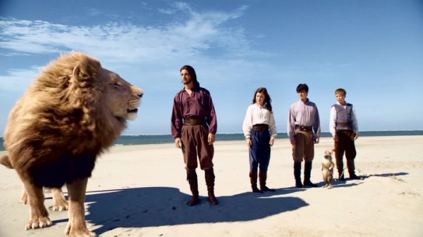 At the world's end, Aslan, the Great Lion of Narnia, consults with Reepicheep and the four young human adventures at the center of the movie.