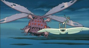 Nausicaä lures a giant ushiabu back to the Fukai with an insect charm.