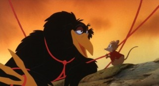 Poor Jeremy is tangled in some red yarn, which Mrs. Brisby kindly frees him from.