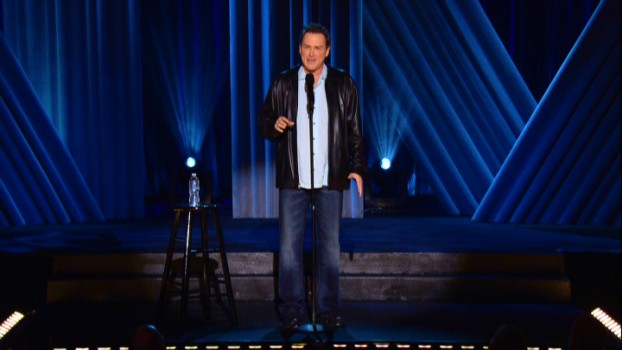 Norm Macdonald's initials subtly and stylishly appear behind him at this documented January 2011 comedy concert in The Fillmore Auditorium of San Francisco.
