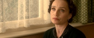 Kristin Scott Thomas plays John Lennon's aunt Mimi Smith, a stern but loving guardian.