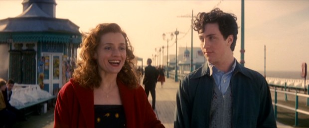 Young John Lennon (Aaron Johnson) connects with his mother (Anne-Marie Duff) in a friendly way.