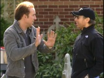 Nicolas Cage practices his mime work for shades-wearing producer Jerry Bruckheimer.