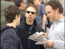 "Justin Bartha, Jerry Bruckheimer, and Jon Turtletaub collaborate on the film, as seen in the featurette ""National Treasure on Location."""