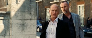 "Four-time Oscar nominee Ed Harris does his best ""worldly badass"" air, complete with heat-packing henchman (Timothy V. Murphy) at his side."