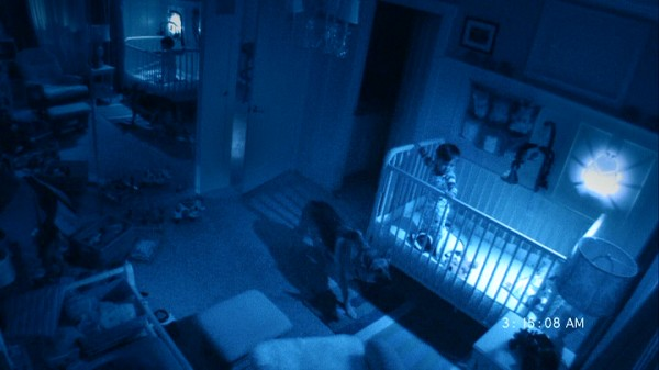 "Young Hunter and Abby the family dog stand on alert just past the soul's midnight in ""Paranormal Activity 2."""