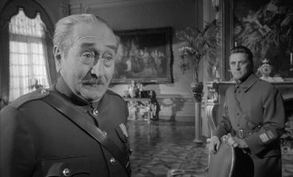 Major General George Broulard (Adolphe Menjou) misreads the Dax's intentions to the Colonel's jaw-clenching disgust.