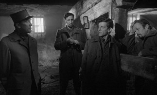 Col. Dax (Kirk Douglas) consults with Private Ferol (Timothy Carey), Private Arnaud (Joseph Turkel), and Corporal Paris (Ralph Meeker), the three French soldiers accused of cowardice in the face of the enemy.