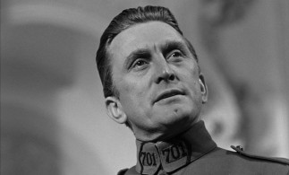 Kirk Douglas tilts his head at a hero's angle while Colonel Dax valiantly defends three soldiers whose lives are threatened by France's unfair court-martial system.