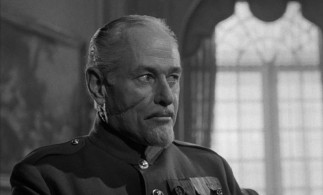 Actor George Macready's prominent facial scar serves (the product of a car accident) serves as a constant reminder of Brigadier General Paul Mireau's evilness.