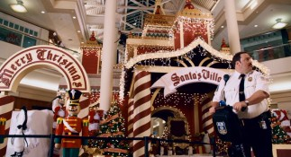While Blart patrols the now-vacant West Orange Pavilion Mall, robber punks acrobatically descend upon the Santa's Village display.