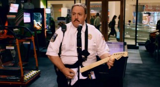 On Black Friday just before terror strikes, Paul Blart rocks out to KISS on Guitar Hero.