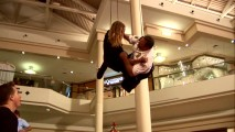 Mike Vallely and Kevin James, not stuntmen, are both suspended from the mall ceiling for their high fall into the colorful ball pit.