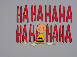 "In love Charlie Brown gets surrounded by giant Ha Ha's. These laughs aren't the good ""you're so funny"" kind, but the bad ""let's laugh at that silly blockhead"" ones."