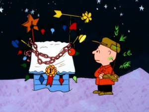 Though glitz won his dog a ribbon in the lights and display contest, Charlie Brown prefers the simple joys of this pathetic little Christmas tree.