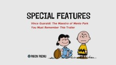 The iconic Peanuts image of Lucy holding the football for Charlie Brown to (not) kick adorns Disc 2's light Special Features menu.