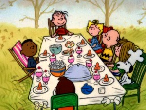 "With the gang gathered around the ping pong table for an early afternoon holiday dinner of popcorn and other treats, Linus prepares to make a speech in ""A Charlie Brown Thanksgiving."""