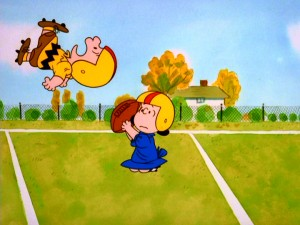 "Lucy's classic football kick fake-out sends Charlie Brown flying a record number of times in ""It's Your First Kiss, Charlie Brown."""