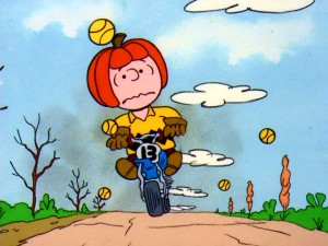 "Charlie Brown proves he's a ""Good Sport"" by enduring a pumpkin helmet and dodging tennis balls in the big motocross race."
