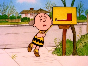Charlie Brown reaches all the way back into his mailbox to make sure he's not missing any Valentine's Day cards. (He's not.)
