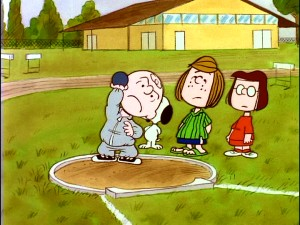 "Charlie Brown struggles with the shot put part of his training with Peppermint Patty and Marcie in ""You're the Greatest, Charlie Brown."" Screencap from 2009's You're a Good Sport, Charlie Brown: Remastered Deluxe Edition DVD. (Click to view full 720 x 480.)"