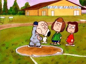 "Charlie Brown struggles with the shot put part of his training with Peppermint Patty and Marcie in ""You're the Greatest, Charlie Brown."" Screencap from 2010's Peanuts 1970's Collection, Vol. 2 DVD. (Click to view full 720 x 480.)"