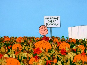 Linus stands alone in a pumpkin patch awaiting the arrival of the Great Pumpkin.
