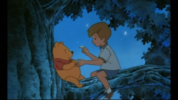 Christopher Robin tries his best to scare Pooh with a twilight E.T. impression. This screencap was taken from the feature itself, presented in widescreen.