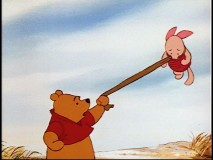 "In the Oscar-winning short ""Winnie the Pooh and the Blustery Day"", Pooh grabs onto his pal."