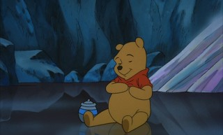 Pooh sits contently, knowing that the rumbly in his tumbly won't last much longer.