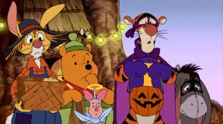 Scarecrow Rabbit, honey pot Pooh, angel Piglet, superhero Tigger, and bandit Eeyore take a break from vegetable trick-or-treating to hear Roo's plight.