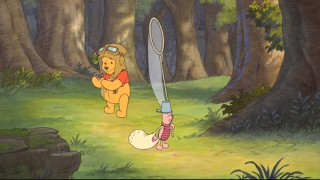 Pooh undermines Piglet's jelly bean trail.