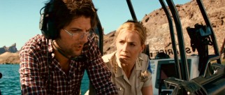 Looking smart and heroic, Novak (Adam Scott) and Sheriff Julie Forester (Elisabeth Shue) seem ready to identify and conquer Lake Victoria's piranha problem.