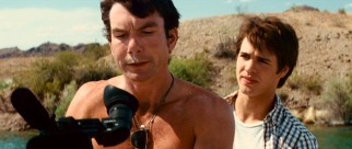 With cocaine on his upper lip, Derrick Jones (Jerry O'Connell) grabs the camera from Jake (Steven R. McQueen) to ensure the filming of a nude parasailer.